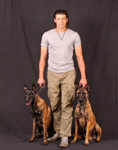 Ivan with Two Malinois Dogs